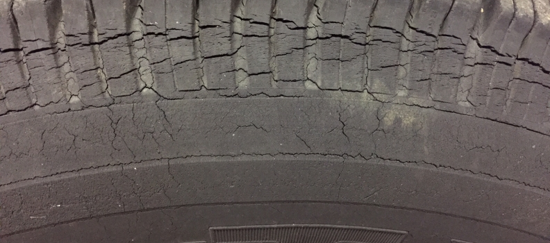Dry rot on the tires will look cracked and sometimes have a greenish weathered look.