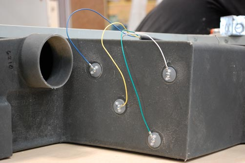 Sensors go through the tank wall and the probes stick into the inside of the tank.